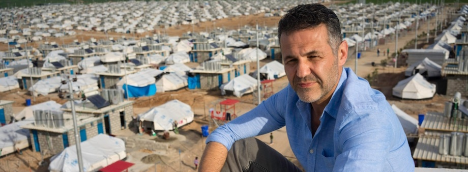 UNHCR Goodwill Ambassador and acclaimed author Khaled Hosseini -  himself a refugee from Afghanistan - poses for a portrait above Darashakran Refugee Camp in the Kurdistan Region of Iraq on 24 March, 2014.
